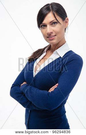 Smiling businesswoman standing with arms folded isolated on a white background and looking at camera