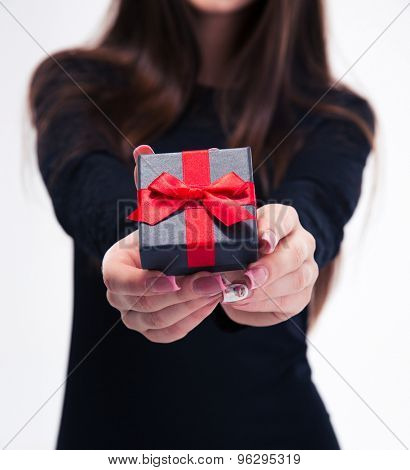 Closeup portrait of a female hands holding jewerly gift box