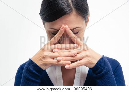 Portrait of a thoughtful businesswoman isolated on a white background