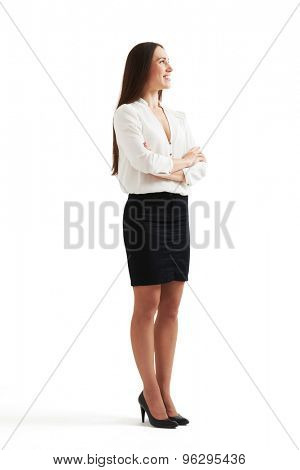 smiley businesswoman in formal wear with folded hands looking up. isolated on white background