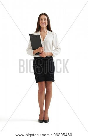 full-length portrait of smiley woman in formal wear holding folder and looking at camera. isolated on white background