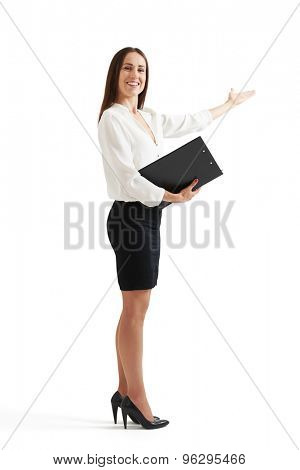 full length portrait of happy businesswoman with folder pointing her hand at something. isolated on white background