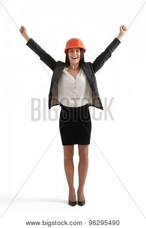 happy businesswoman in formal wear and orange hardhat raising her hands up. isolated on white background