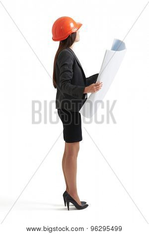 businesswoman in hardhat holding blueprint and looking up. isolated on white background