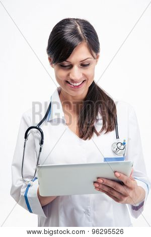 Smiling female medical doctor using tablet computer isolated on a white background