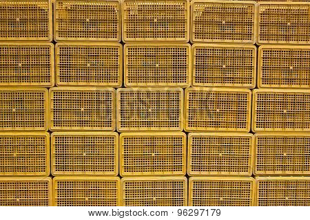 Background With Plastic Baskets Stacked In The Bazaar.