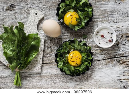 Fresh Sorrel And Eggs On A Light Wooden Background, Ingredients For Making Baked Eggs