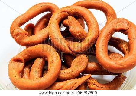 Kodebale ~ Indian savouries kept on a white background
