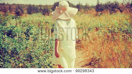 Fashionable Woman Walking In Park