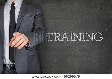 Training on blackboard with businessman