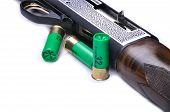 picture of shotgun  - Detail of a shotgun and bullets isolated on white background - JPG