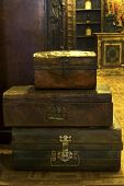 stock photo of old suitcase  - Indian iron old vintage suitcases stacked on each other - JPG