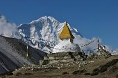 image of snow capped mountains  - Stupa and snow capped mountain Thamserku. Scene in Dingboche, Everest Region. ** Note: Visible grain at 100%, best at smaller sizes - JPG