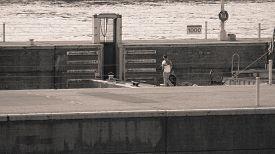 image of barge  - Barge Worker on Barge Lowering in Lock - JPG