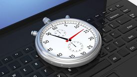 stock photo of chronometer  - Silver chronometer on black laptop keyboard - JPG