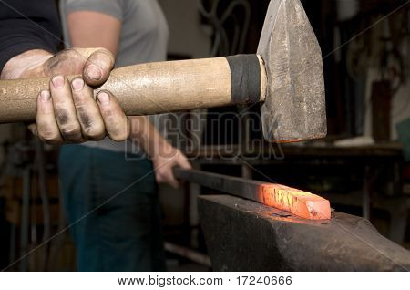 hands at work in blacksmithy