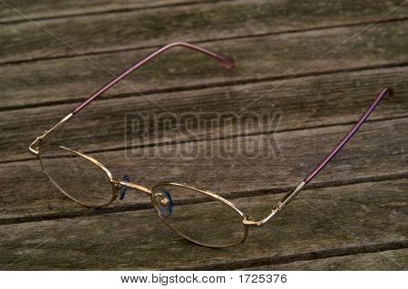 Gold Glasses On Wood