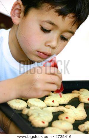 Boy Decorating Dinosaur Cookies