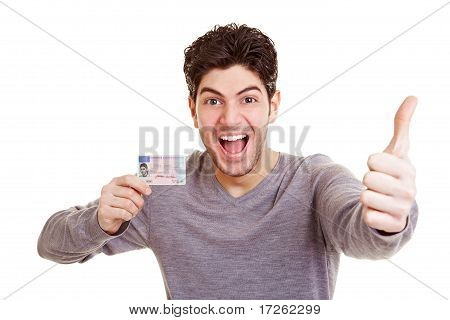Man With Drivers License Holding Thumb Up