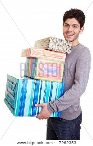 Man Carrying Many Christmas Gifts