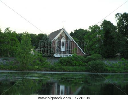 Modern Brick Church overlooking a Pond