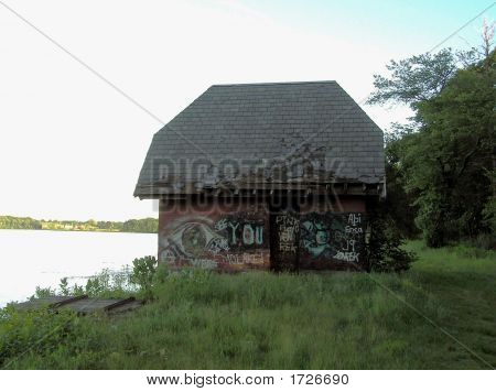 Graffiti on Brick Building by lakeside