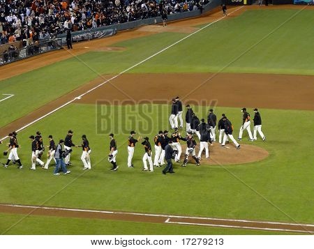 Giants High Five Each Otheron Field After Winning Game