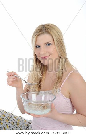 Beautiful Female Having Muesli Cereals For Breakfast. Isolated On White