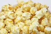 foto of matinee  - yellow buttered popcorn on a white background 