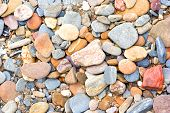 Polished Pebbles By The Beach poster