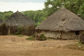 foto of mud-hut  - Mud and thatch huts typical of African villages - JPG