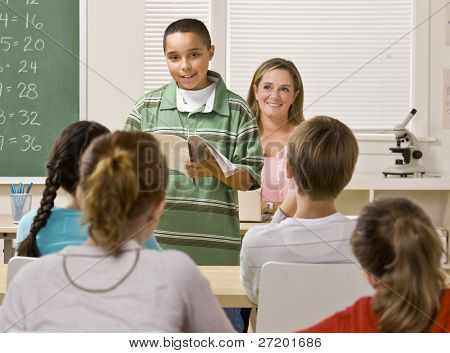 Student giving report in classroom