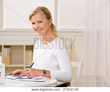 Woman writing checks