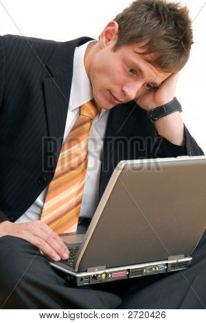 Unhappy Businessman With Computer
