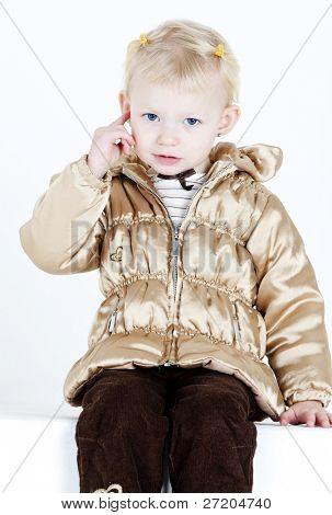 portrait of little girl showing her earrings