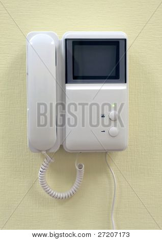 Intercom on yellow wall