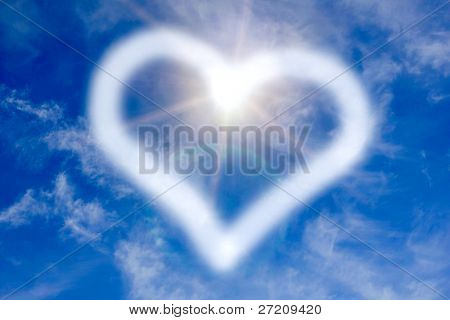Heart sign on the blue sky with sunshine