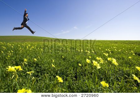 Businessman Jumping On The Field