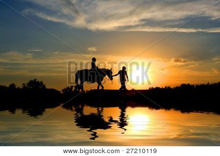 Two travelers on sunset background