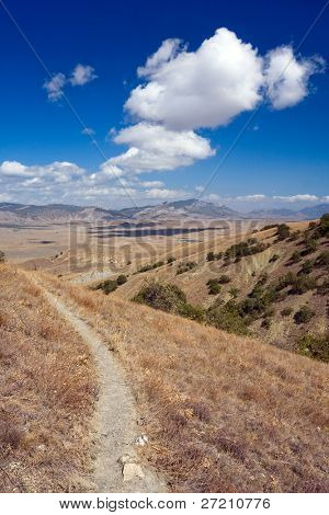 footpath in mountains in nice autumn day