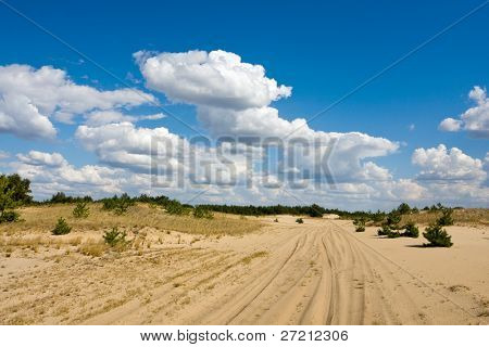 path in sands under nice sky with clouds