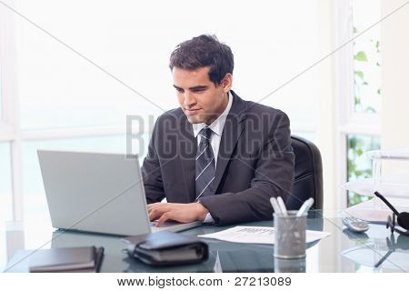 Businessman working with a laptop in his office