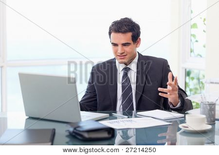 Upset businessman working in his office