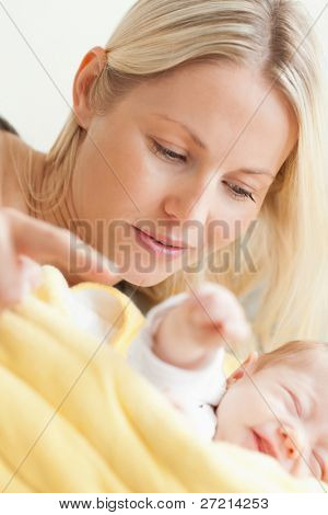 Close up of young mother relaxing next to her sleeping baby