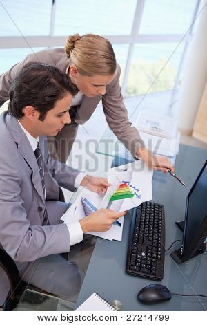 Portrait of a focused business team looking at a graph in an office