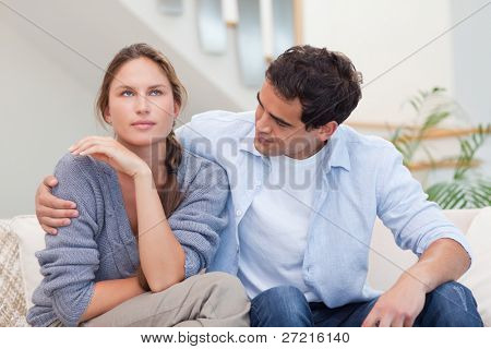 Woman being mad at her husband in their living room