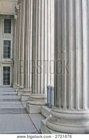 Stone Pillars Outside A Court