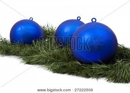 Blue christmas bulbs on a white background