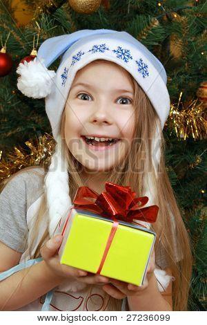 Joyful Girl With Christmas Present