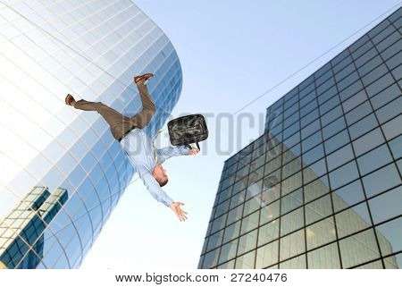 A businessman falls from a building rooftop after too much emotional stress at work caused him to commit suicide.
